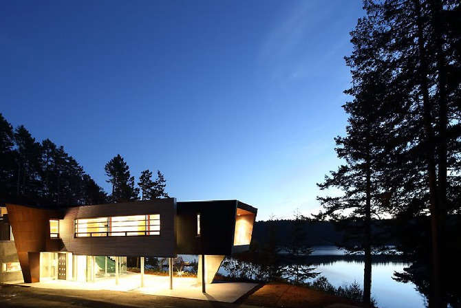 Modern Steel West Coast fusion building exterior at night on Pender Island built by Dave Dandeneau of Gulf Islands Artisan Homes