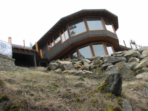 Exterior cliff perspective of West Coast Home on Pender Island built by Dave Dandeneau of Gulf Islands Artisan Homes