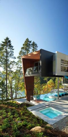 Modern Steel West Coast fusion building exterior pool to ocean on Pender Island built by Dave Dandeneau of Gulf Islands Artisan Homes